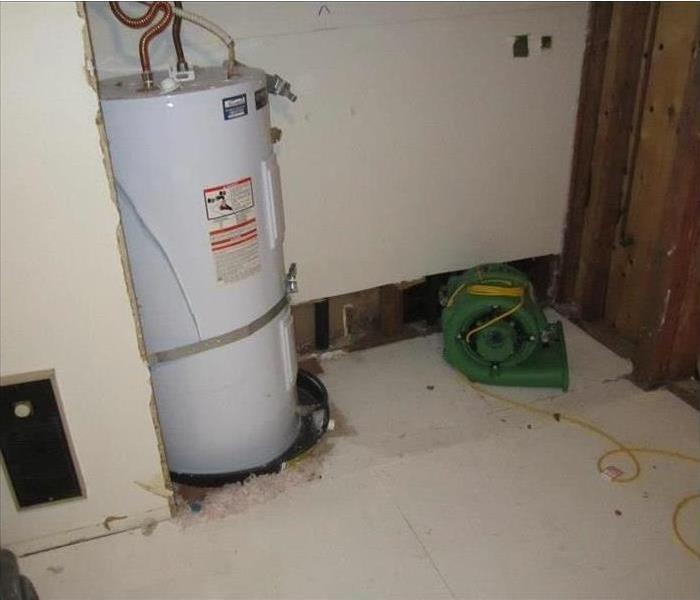 water heater with flooring pulled out
