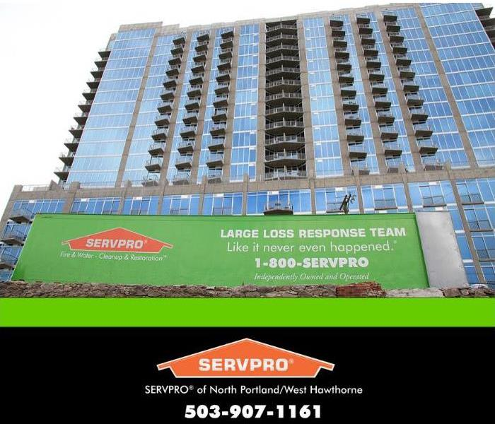 large SERVPRO trailer in front of large high rise building