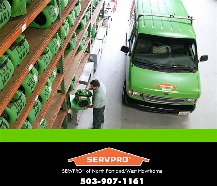 SERVPRO tech in warehouse with equipment