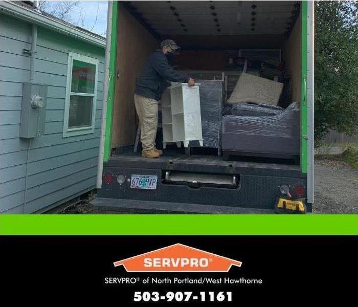 SERVPRO tech bringing contents out of moving truck